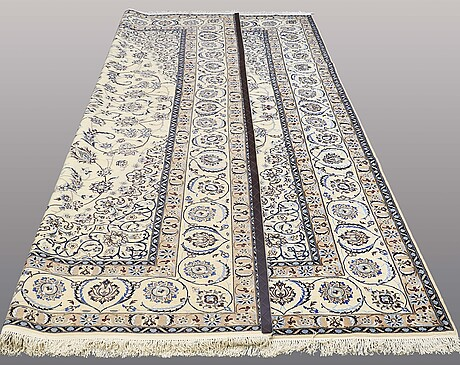 A carpet, nain part silk, s.k 9laa, 350 x 252 cm.