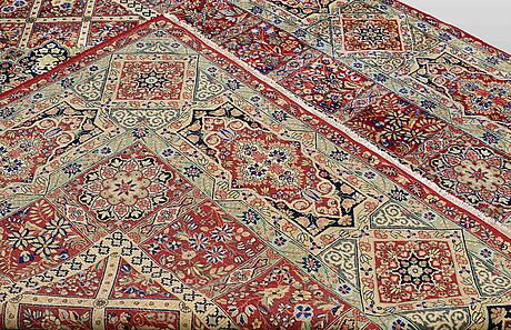 A carpet, kerman, ca 335 x 257 cm.