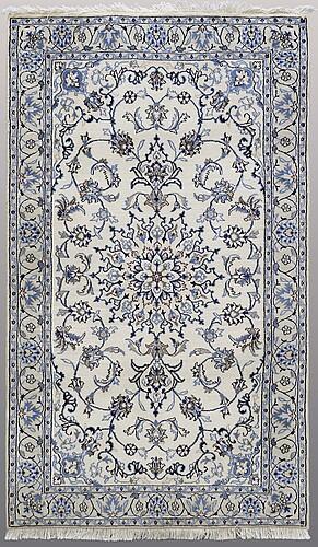 A rug, nain part silk, ca 200 x 119 cm.