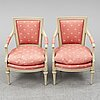 A pair of gustavian style armchairs, second half of the 20th century.