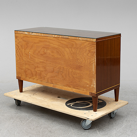 A chest of drawers, mid 20th century.