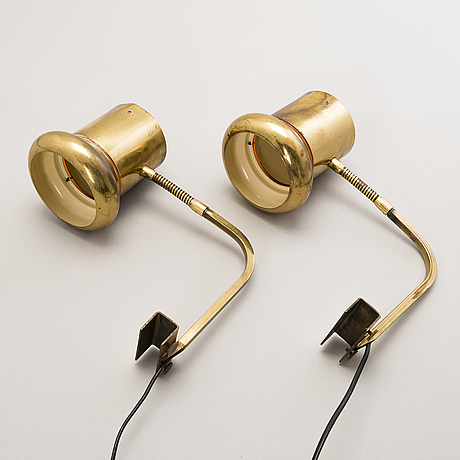Kai ruokonen, a pair of brass wall lamps.
