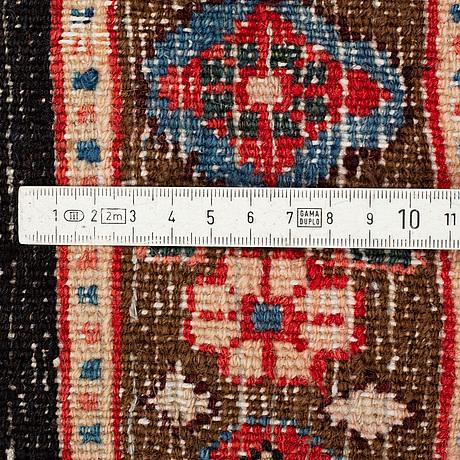 A carpet, moud, ca 370 x 282 cm.