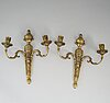 A pair of brass louis xvi style wall sconces, 20th century.