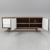 Michael h nielsen, a walnut 'floow' nsideboard from bolia.