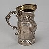 A small silver jug, late 19th-early 20th century.