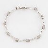 An 18k white gold bracellet set with round brilliant-cut diamonds.
