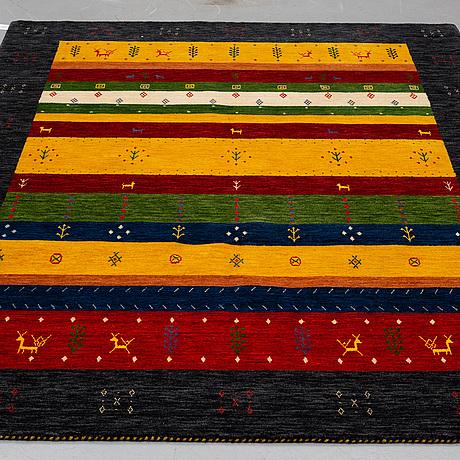 An oriental carpet, so called lori, ca 240 x 170 cm.
