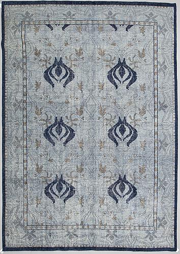 An oriental carpet, ca 360 x 263 cm.