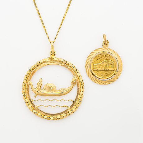 A set of 14k and 18k gold necklace and a pendant.