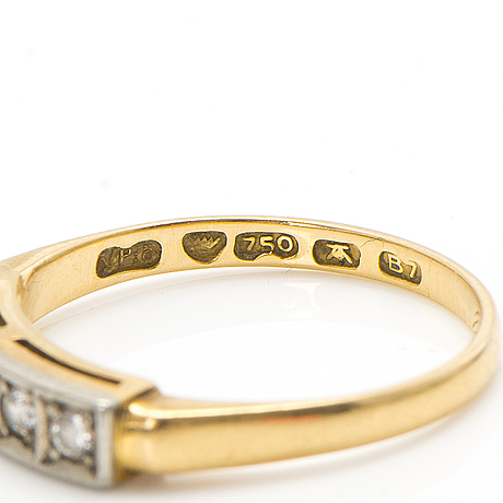 An 18k gold ring with diamonds ca. 0.22 ct in total. päiviö veikko, turku 1955.
