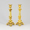 A pair of brass candlesticks, late 19th century.