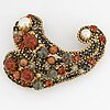 A nina ricci brooch yellow metal set with stones and imitation pearls.