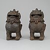 A pair of chinese iron fo dogs, 20th century.