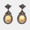 A pair of 14k gold and silver earrings with citrines and single-cut diamonds ca. 0.90 ct in total.