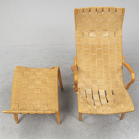 An mid 20th century easy chair  and stool by bruno mathsson for karl mathsson värnamo.