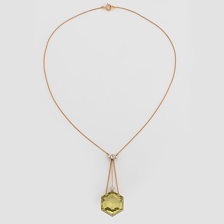 An 18k gold and platinum pendant set with a faceted beryl, old-cut diamonds and pearls.