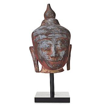 108. A wooden scultpure of Buddhas head, Thailand/Burma, 20th Century.