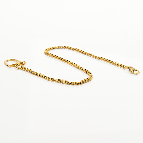 An 18k gold pocket watch chain.