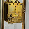 A french onyx and brass mantel clock, first half of the 20th century.