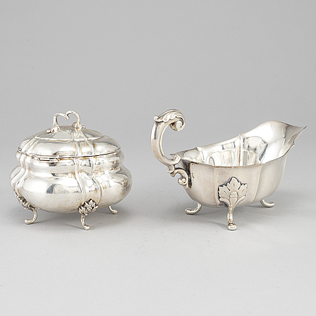 A rococo-style 20th century silver cream-jug and sugar-box, swedish import marks.