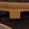 Gucci, a handbag.