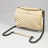 Yves saint laurent, a beige, quilted leather 'collège medium' handbag.