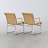 A pair of 'mondo' armchairs by karl erik ekselius for joc, later part of the 20th century.