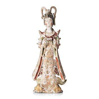 549. A elegant pottery figure of a court lady, Tang dynasty (618-907).