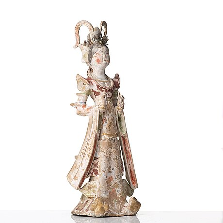A elegant pottery figure of a court lady, tang dynasty (618-907).