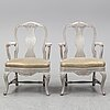 A pair of rococo style armchairs, second half of the 20th century.
