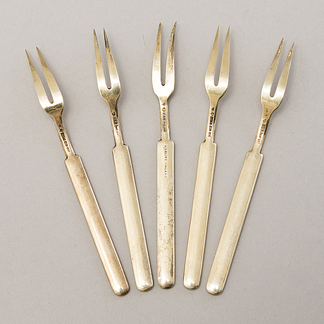 A 1950s silver cocktail shaker, 6 cocktail sticks and five enamelled forks, kultakeskus och tillander, finland.