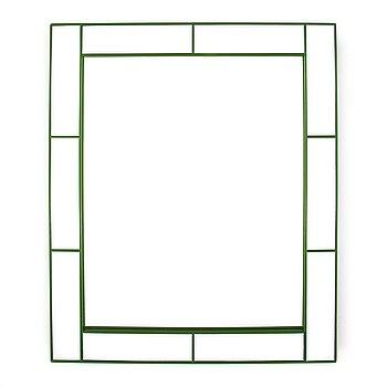 A Mirror by Josef Frank for Firma Svenskt Tenn.