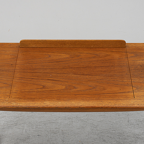 A mid 20th century oak table with a writing board.