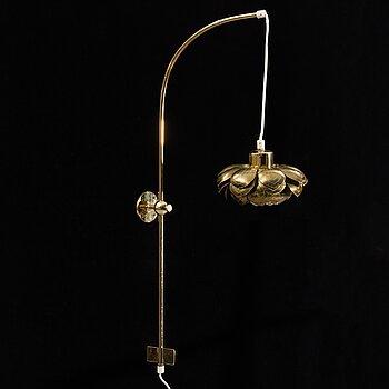 A model 2600 brass wall lamp by Josef Frank for Firma Svenskt Tenn.