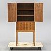A walnut cabinet by carl malmsten.