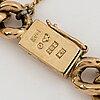 An 18k gold bracelet.