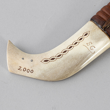 Stefan groth, a sami reindeer horn knife, signed sg and dated 2000.