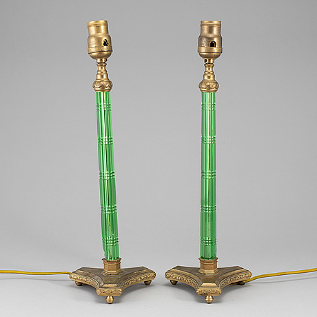 A pair of green glass and gilt metal table lamps, unmarked.