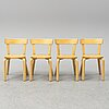 Alvar aalto, a set of table and four chairs.