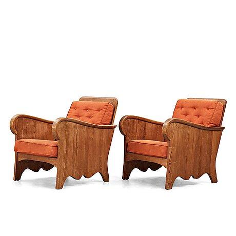 "Axel einar hjorth, a pair of stained pine ""lovö"" easy chairs, nordiska kompaniet, sweden 1930's."