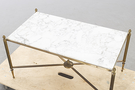 A mid/second half of the 20th century coffee table in brass and marble.
