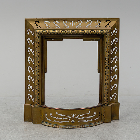 A hearth surround, brass, first half of the 20th century.