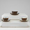 A set of three blue and white cups with dishes, qing dynasty, kangxi (1662-1722).