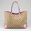 Gucci, a monogram canvas and pink metallic leather handbag.