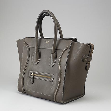 CÉline, a 'luggage' leather hand bag.