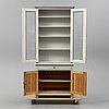 A  display cabinet, ca 1900.