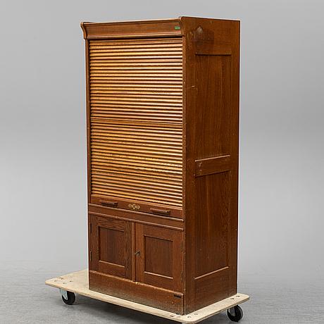 A circa 1900 oak cabinet,