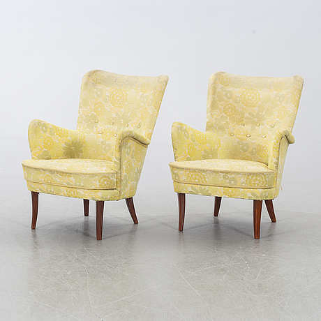 "Carl malmsten, a pair of ""stora furulid"" armchairs, second half of the 20th century."