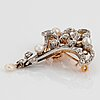An 18k gold and platinum brooch set with old- and rose-cut diamonds.